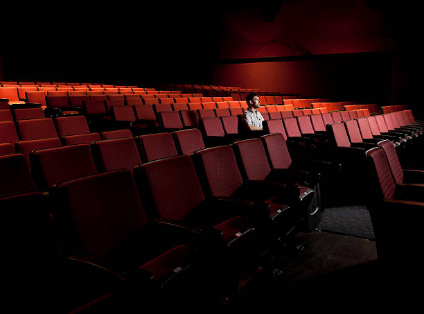 One Man in an Empty Theater stock photo