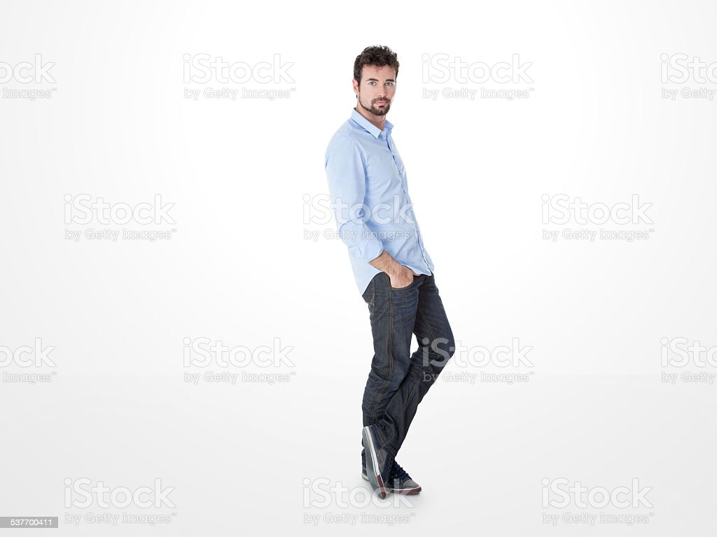 one man leaning against the wall stock photo