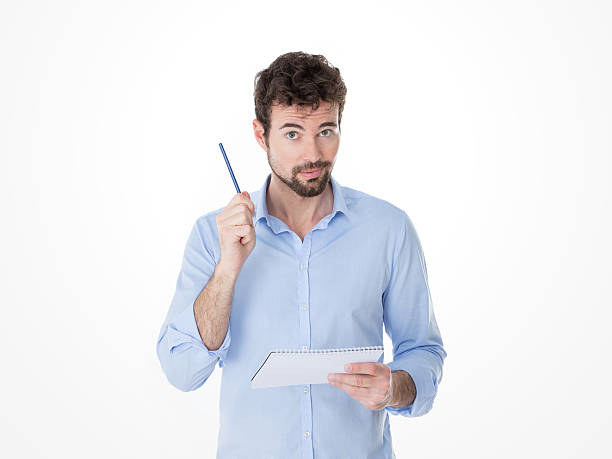 one man lifts up his pen to make a question stock photo