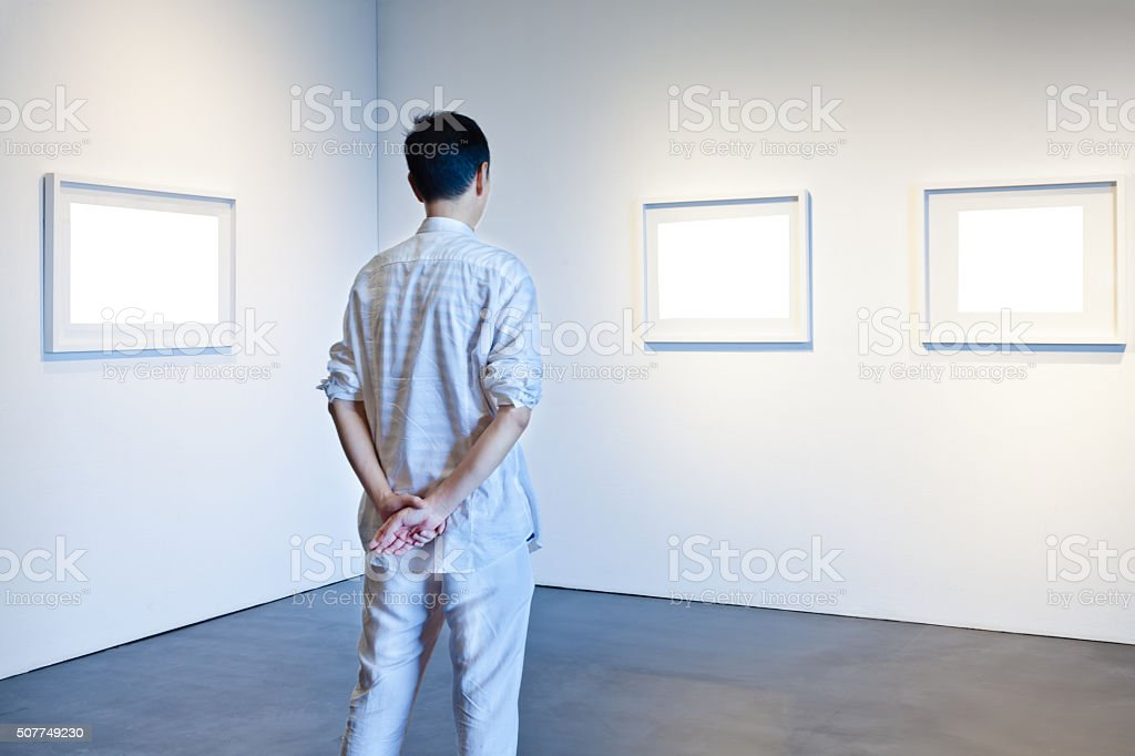 One Man Looking At White Frames In An Art Gallery Stock Photo & More ...