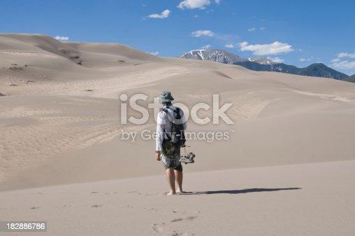 Tourist climbing mountain
