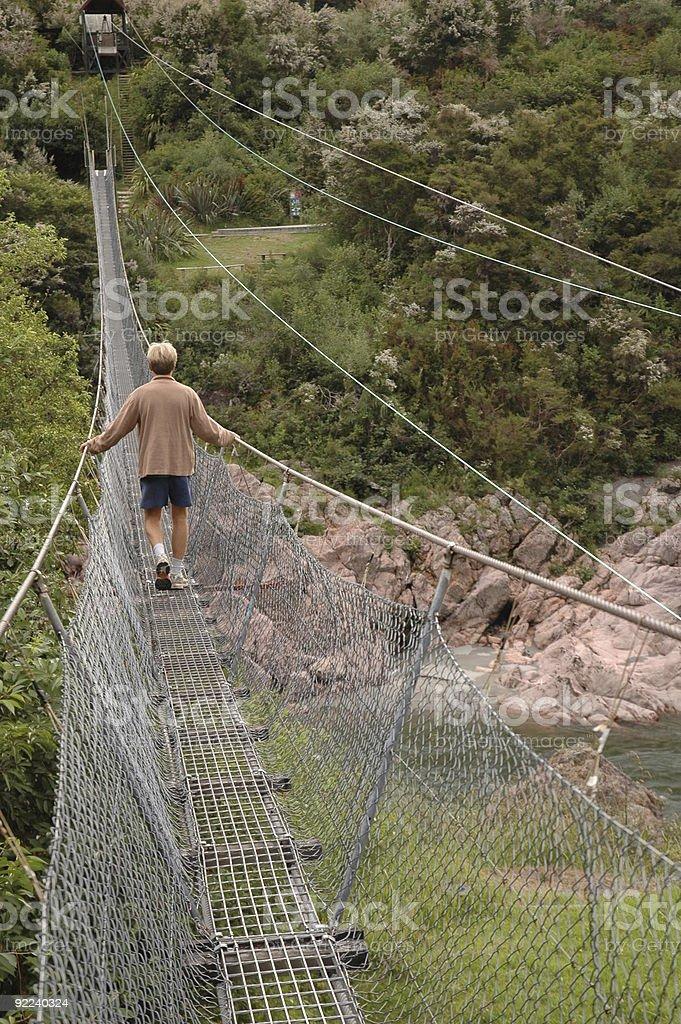 One man on a suspension bridge, Buller Gorge, New Zealand royalty-free stock photo