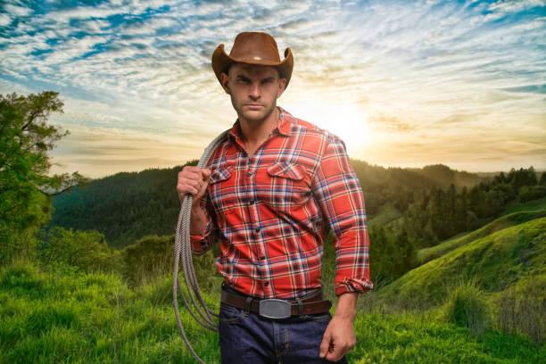 Ein Mann nur / eine Person / Taille nach oben / Frontansicht von 30-39 Jahre alt erwachsene schöne Menschen braune Haare kaukasischen männlichen / junge Männer Cowboy stehend Tragen Jeans / Hose / Holzfäller Shirt / kariertes Hemd / Button-down-Shirt / – Foto