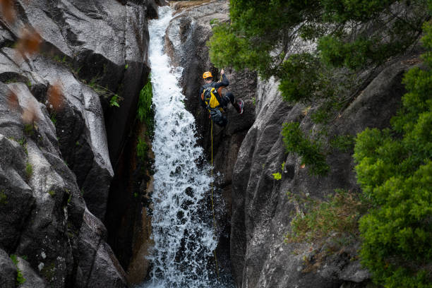One man rappelling the Arado Waterfall (cascata do arado) in the Peneda Geres National Park stock photo