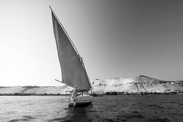 One Man Sailing in Aswan stock photo