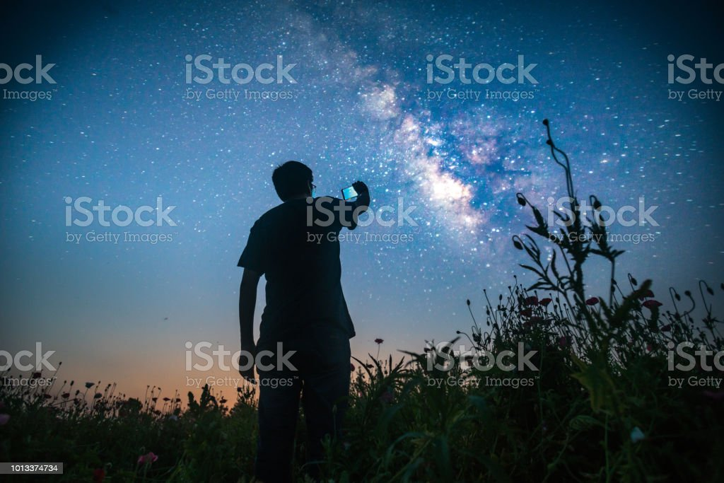 one man standing in the wild looking forward stock photo