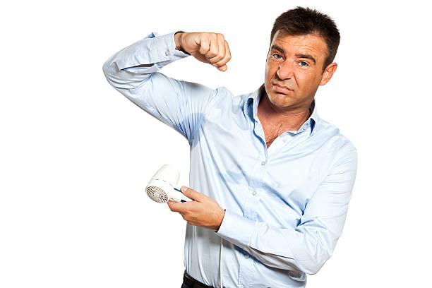 one man sweat stain perspire drying shirt stock photo