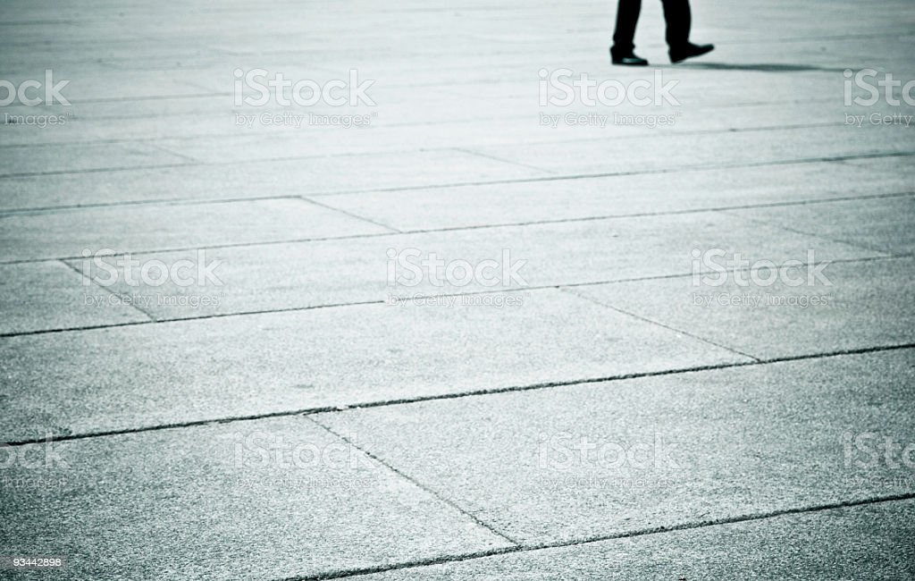 One Man's Feet Walking in a Town Square royalty-free stock photo