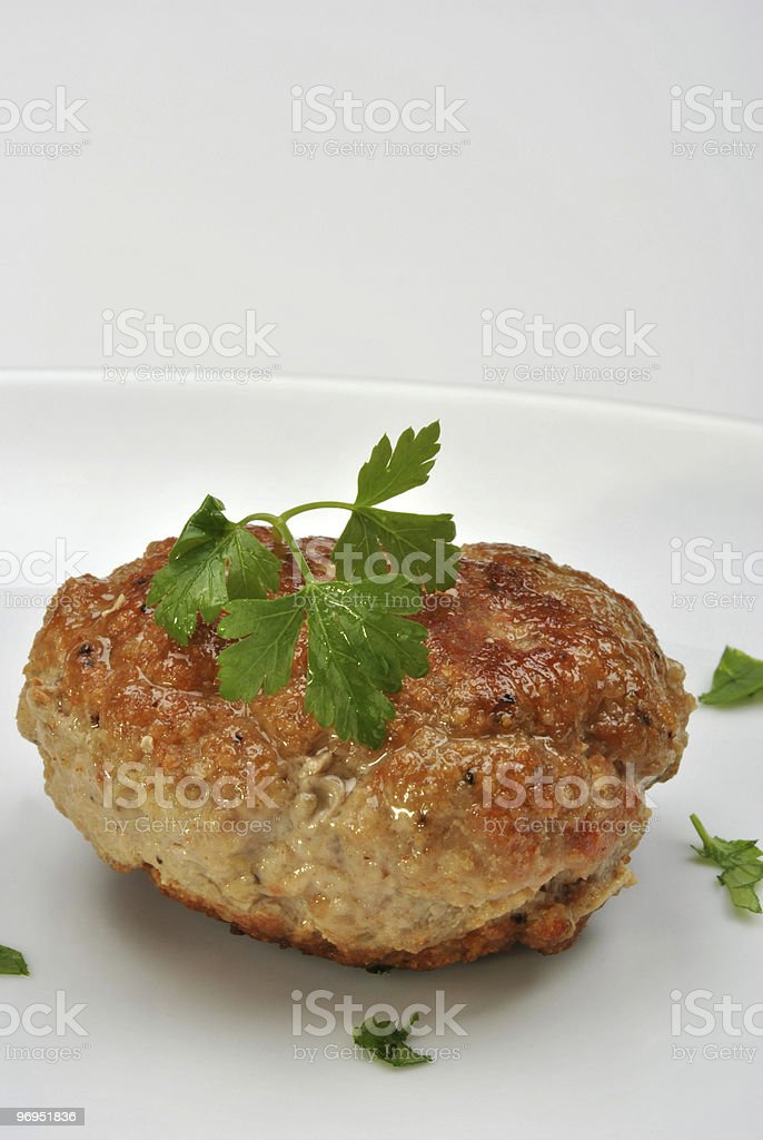 one meat ball with organic parsley on a white plate royalty-free stock photo
