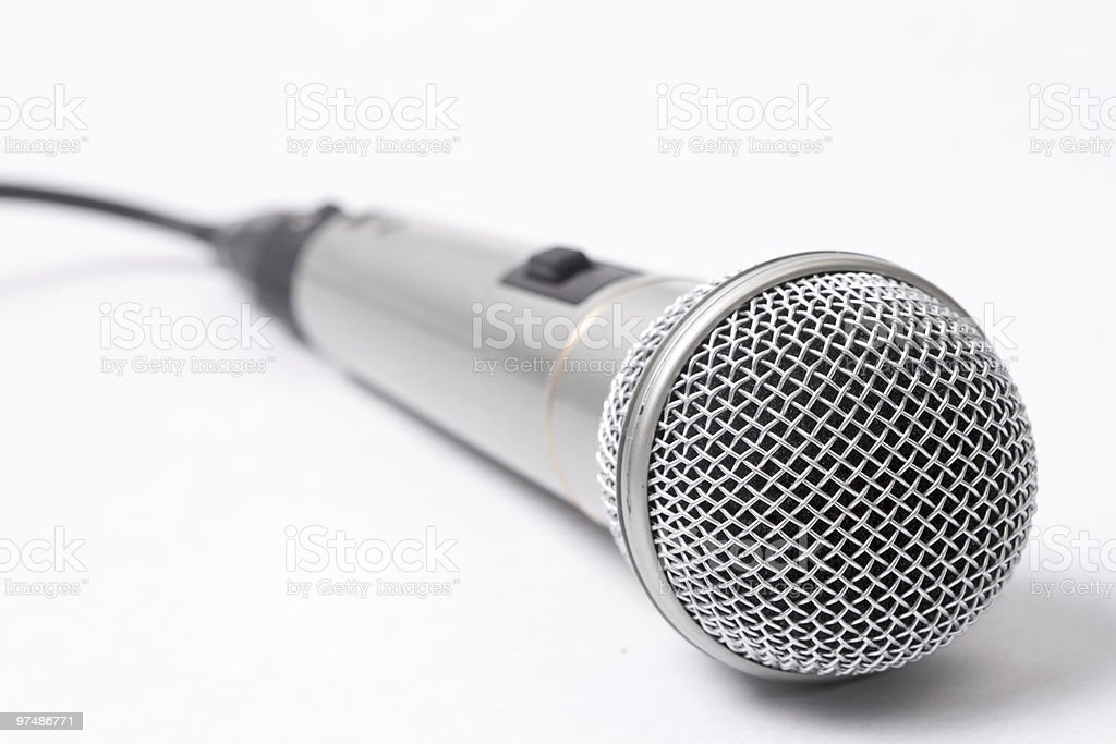 One metallic microphone over white background royalty-free stock photo
