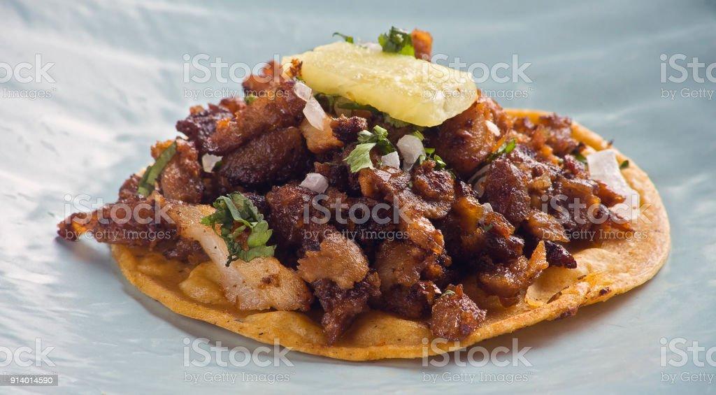One mexican taco al pastor stock photo