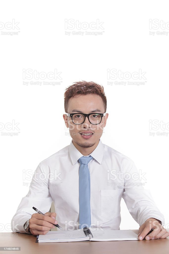 One middle-aged Asian businessman sitting at his desk royalty-free stock photo