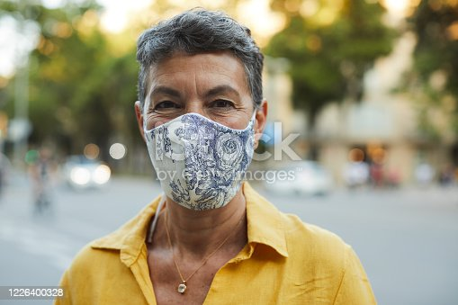 One person wearing a protective mask and smiling