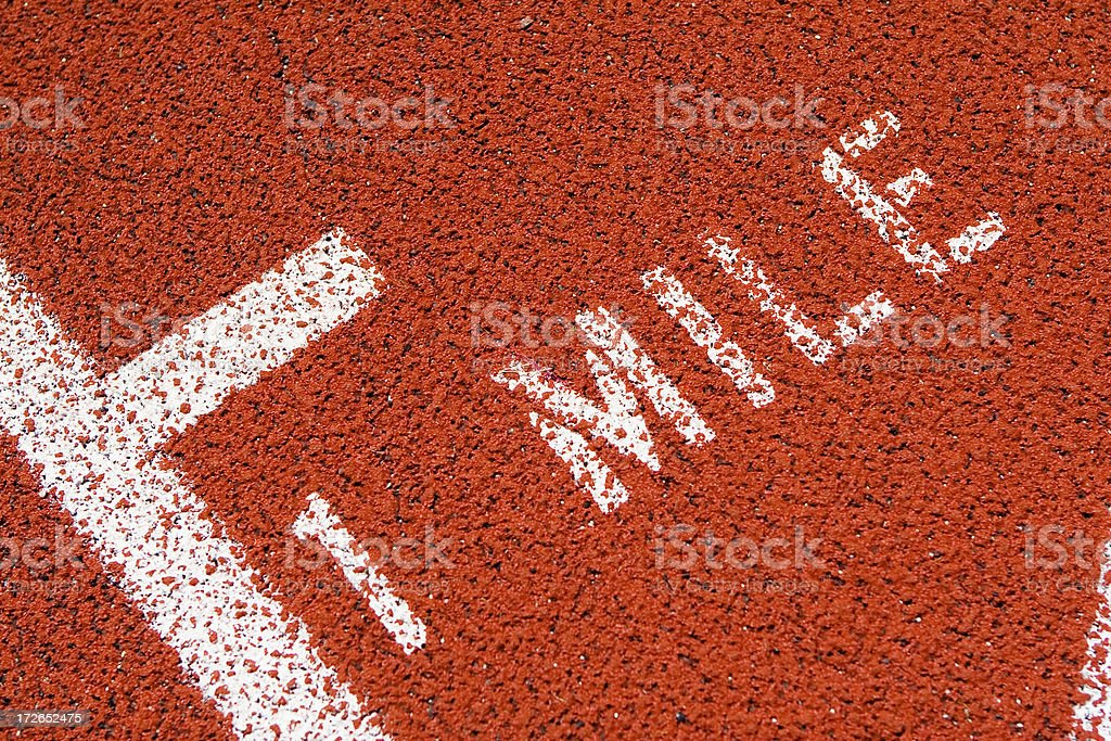 One mile marker on red running track stock photo