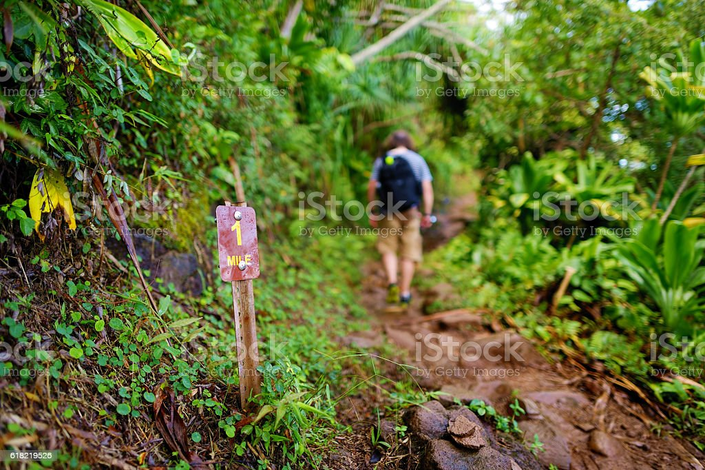 One mile sign on Kalalau trail in Kauai stock photo