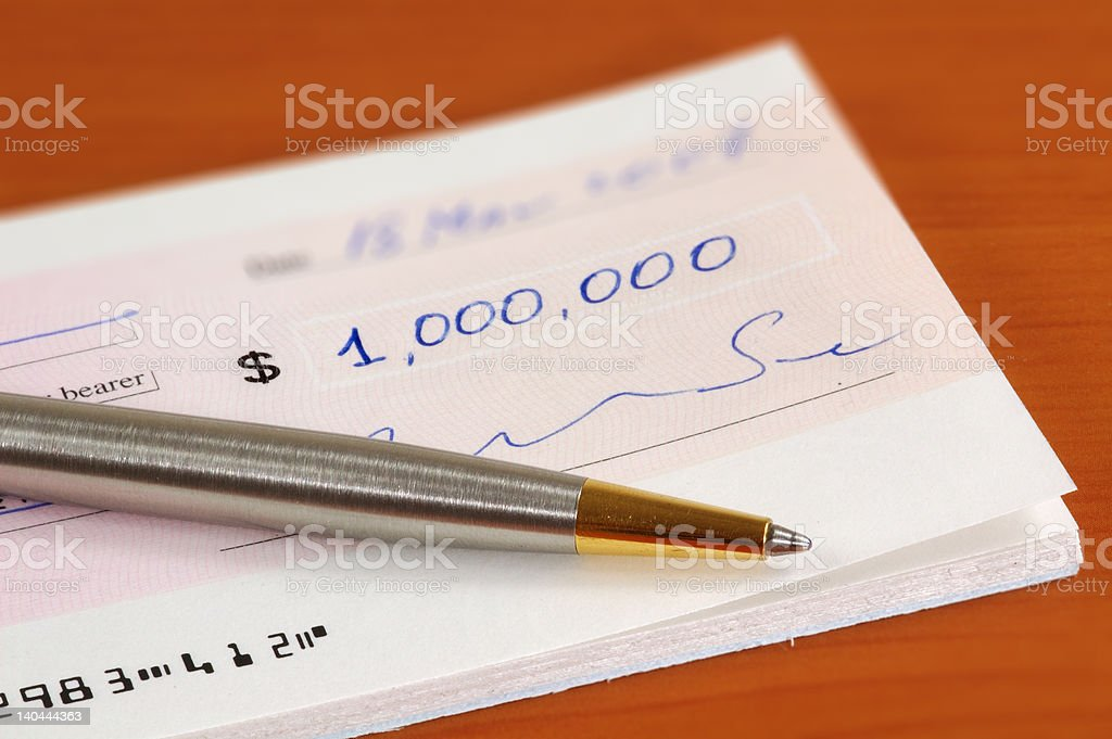 One million dollars cheque and a pen stock photo