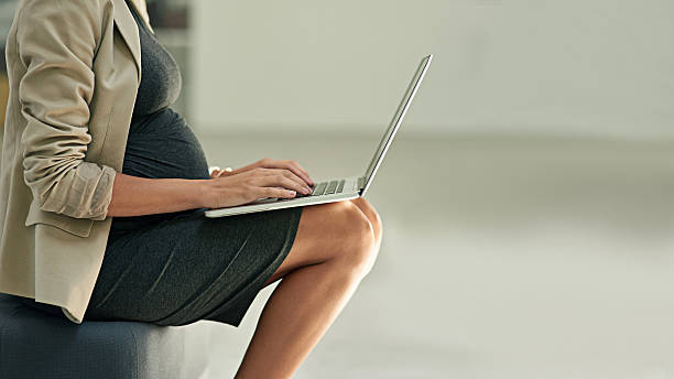 One more email before maternity leave stock photo