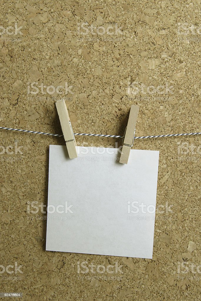 one note hanging on a tread (vertical) royalty-free stock photo