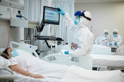 One nurse looking at the medical ventilator screen. ICU COVID ward