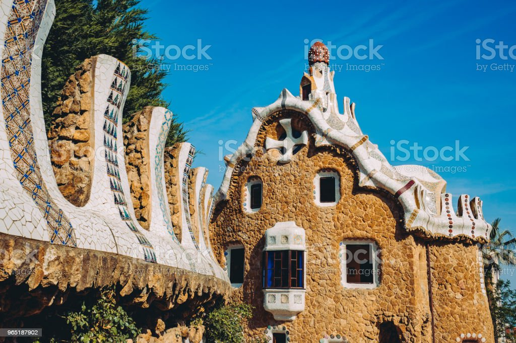 One of a colorful mosaic building in Park Guell in evening warm Sun light, Barcelona, Spain royalty-free stock photo