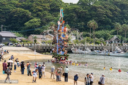 Kodomo area Karatsu city Saga prefecture JAPAN - July 16 2019:  one of Japanese Summer festival. People bearing float on their shoulders. Float is parade through the street and across a seashore in the town. Kodomo Gion Festival. Held on July 16th and 17th.