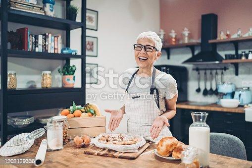 Senior woman showing a sweet pie