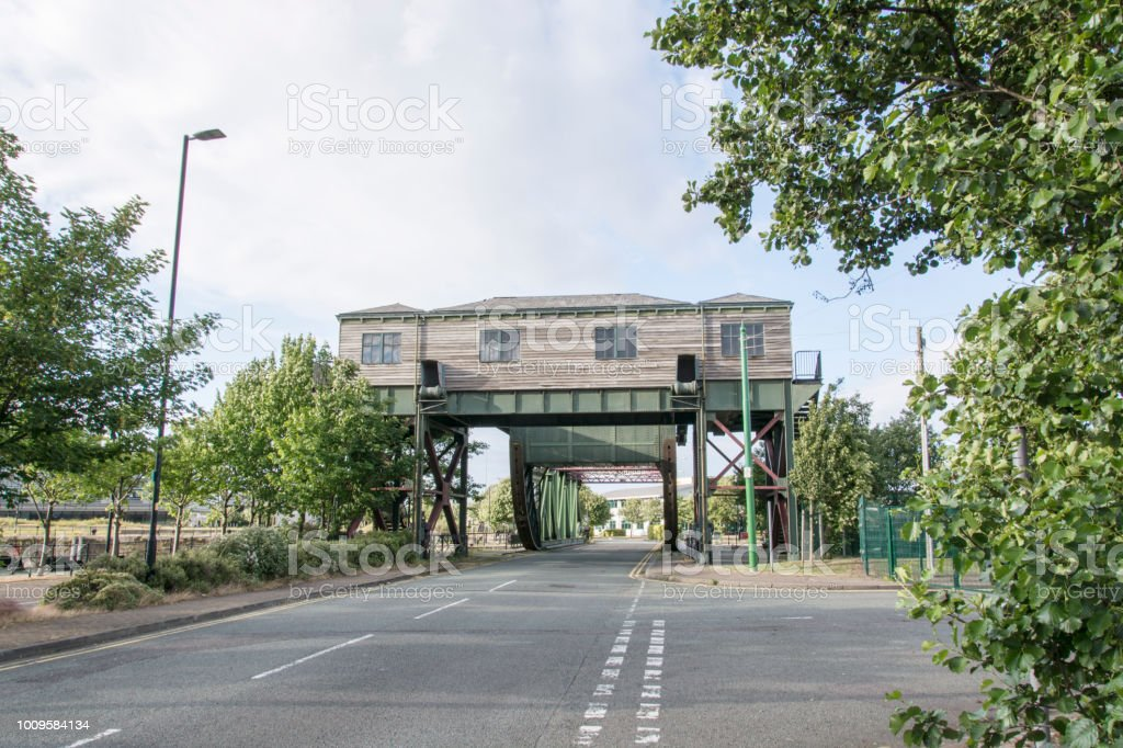 One of the bridges at the Four Bridges road crossing over the docks between Birkenhead and Wallasey, Merseyside, England. stock photo