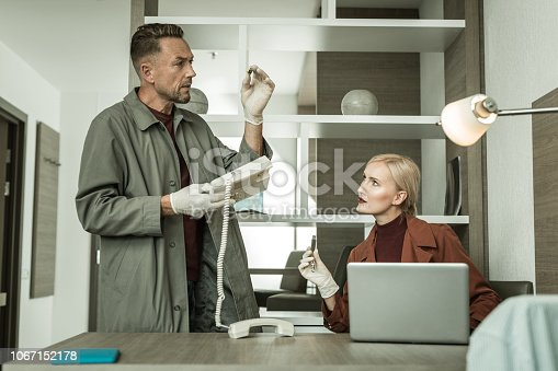 istock One of the investigators preciously inspecting spy equipment 1067152178