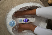 Pedicure and foot massage in beauty salon