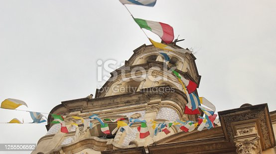 One of the towers of the San Telmo church, with lots of flags in the front of Argentina, Italy and the Vatican (Buenos Aires)