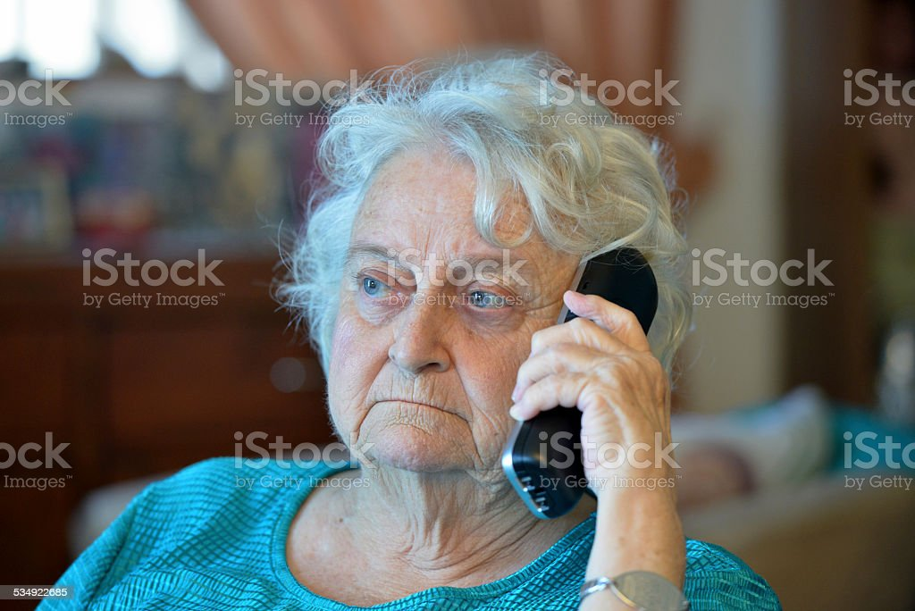 One old lady on the phone royalty-free stock photo