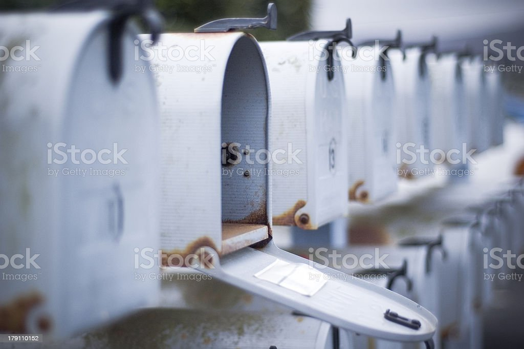 one open mail box in a row stock photo