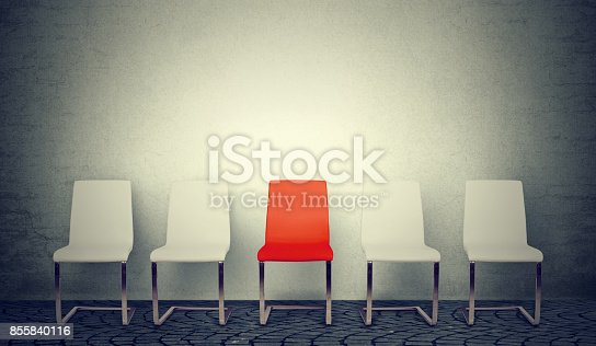 One opening for the job business concept. Row of white chairs and one red in the middle