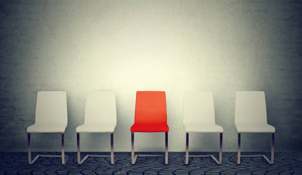 one opening for the job business concept. row of white chairs and one red in the middle - job search stock photos and pictures