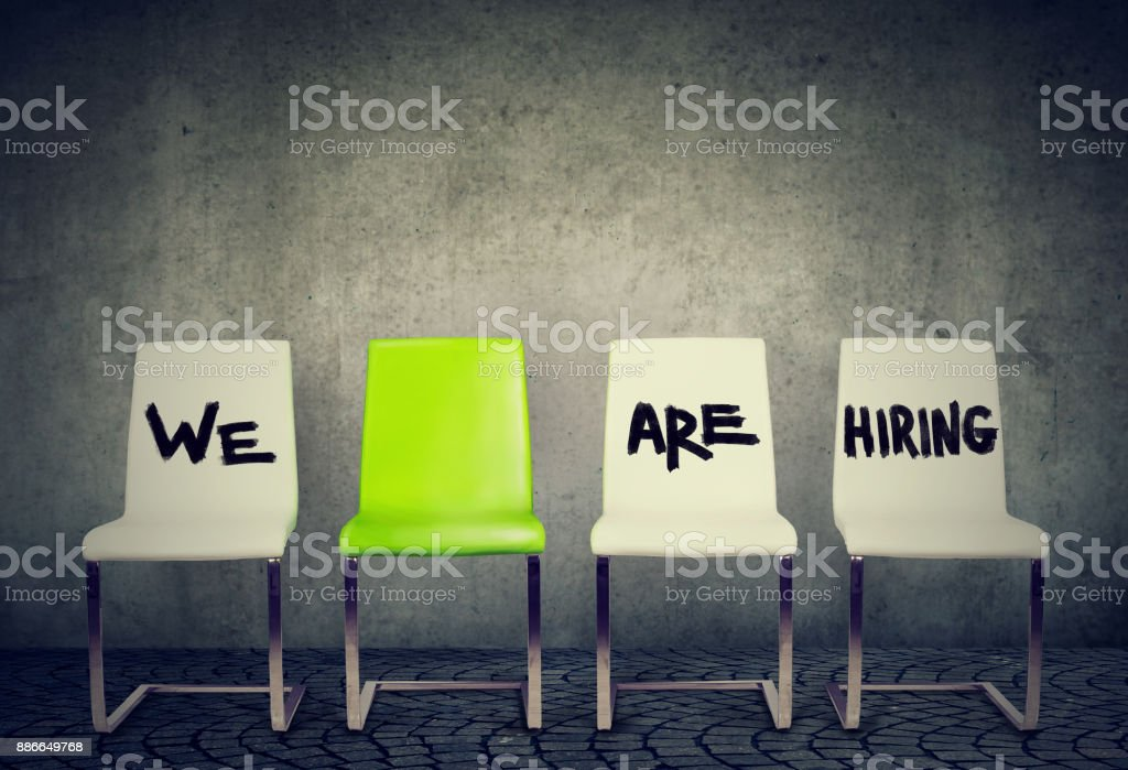 One opening for the job business concept. Row of white chairs and one green among them stock photo