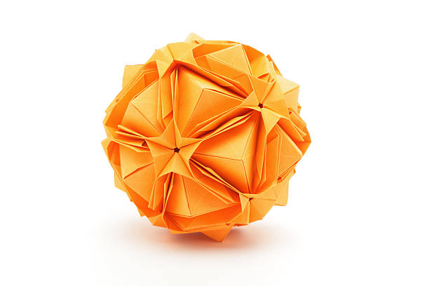 one orange origami polyhedron paper craft design - veelvlakkig stockfoto's en -beelden