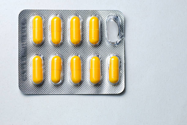 One packs of pills isolated on white background stock photo