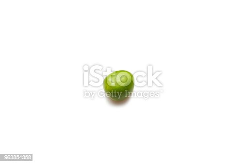 One pea on a white background