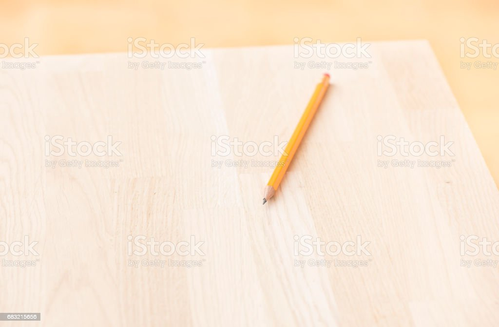 One pencil lying on wood table 免版稅 stock photo