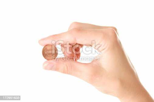 Woman's hand holding an american penny. Isolated on white.