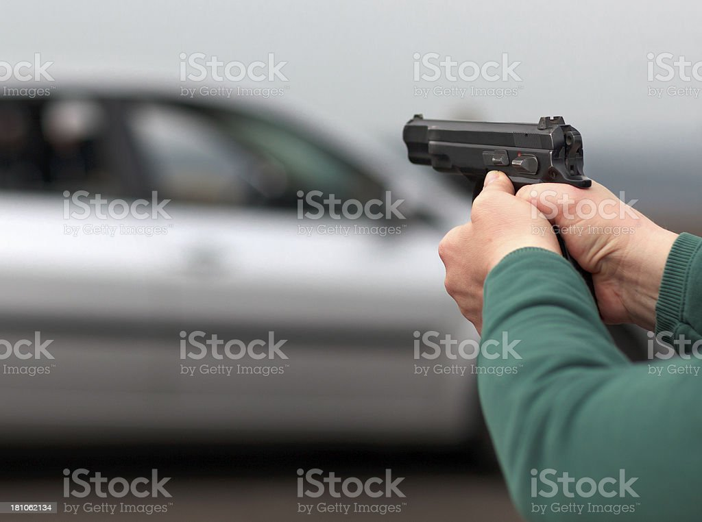 One person are taking aim at the in of car royalty-free stock photo