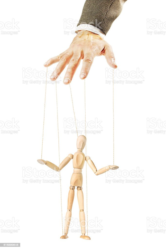 One person controls the other like a puppet stock photo
