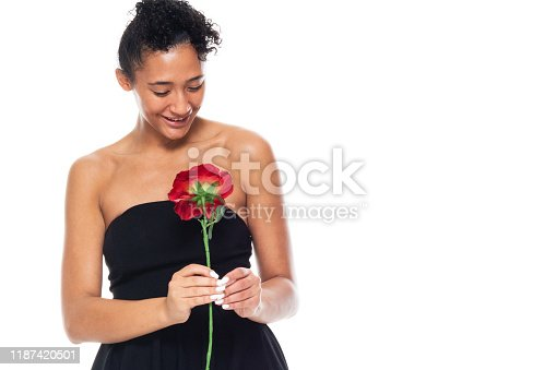 istock One person / front view / waist up of 20-29 years old adult beautiful african ethnicity / african-american ethnicity female / young women standing wearing dress who is smiling / happy / cheerful / love - emotion / cool attitude with copy space 1187420501