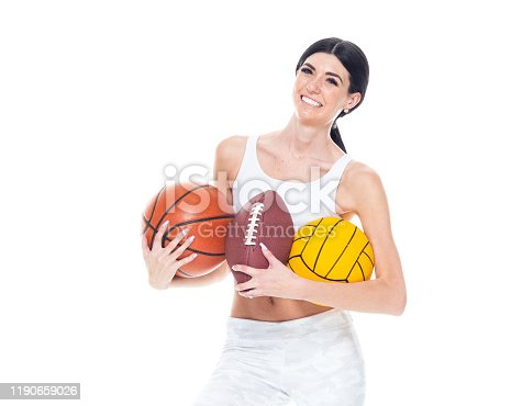 One person / front view / waist up of 20-29 years old adult beautiful / tall person caucasian young women / female soccer player / baseball player / american football player / athlete / sportsperson wearing spandex / sports bra / leggings / sports clothing who is smiling / happy / cheerful who is hitting and holding soccer ball / baseball bat / sports bat / water polo ball / playing soccer - sport / using sports ball / sport / baseball - sport / batting - sports activity / swinging / american football - ball / soccer field