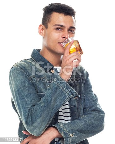istock One person / full length / front view / waist up of 20-29 years old adult handsome people / tall person african ethnicity / african-american ethnicity male / young men standing in front of white background wearing denim jacket / cool attitude 1175543317