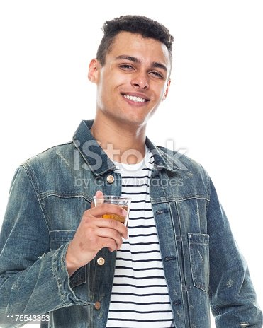 istock One person / full length / front view / waist up of 20-29 years old adult handsome people / tall person african ethnicity / african-american ethnicity male / young men standing in front of white background wearing denim jacket / cool attitude 1175543353