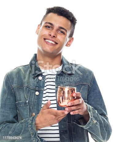 istock One person / full length / front view / waist up of 20-29 years old adult handsome people / tall person african ethnicity / african-american ethnicity male / young men standing in front of white background wearing denim jacket / cool attitude 1175543474