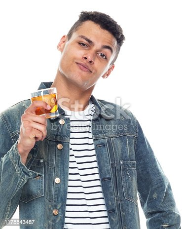 istock One person / full length / front view / waist up of 20-29 years old adult handsome people / tall person african ethnicity / african-american ethnicity male / young men standing in front of white background wearing denim jacket / cool attitude 1175543487