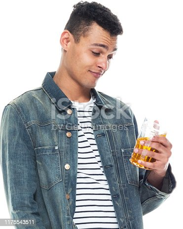 istock One person / full length / front view / waist up of 20-29 years old adult handsome people / tall person african ethnicity / african-american ethnicity male / young men standing in front of white background wearing denim jacket who is drunk / drinking 1175543511