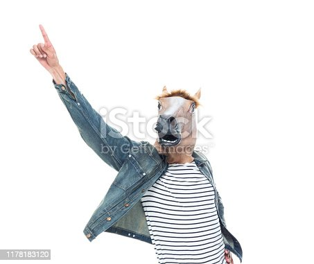 One person / full length / front view / waist up of 20-29 years old adult handsome people / tall person african ethnicity / african-american ethnicity male / young men dancing / exercising in front of white background wearing denim jacket / mask - disguise / costume who is cheerful / joy / humor / cool attitude / horse
